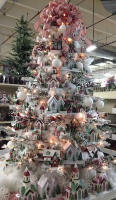 Cristhmas Tree Decorations Ideas : Christmas at A&B Floral in Charlotte NC. Marge Travis and Michael do a great job each year. Christmas Village Houses, Christmas Village Display, Christmas Tree Themes, Christmas Villages, Holiday Tree, Xmas Trees, Putz Houses, Gingerbread Houses, Fairy Houses