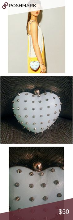"Birthday Sale 🎉 From the collaborative collection of  Melody Ehsani + Mata Hari   The M.E. Heart || Studded Clutch Purse  Light blue with silver hardware detail.   Preowned but never used. .still has original tags.   Made with genuine leather  Features a 19.5 "" chain strap  Clutch length 6.5 "" and 5.5 "" height  Open/ depth is about 2.5-3 ""  This item is adorable and fun..just never got around to using it.   Item is sold in the condition it came in originally. .please look at photos…"