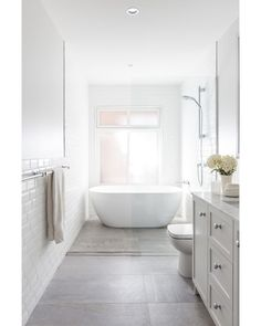 guest bathroom The soft palette of the Guest Bathroom at our project glows with natural light! Styling by megan_morton Photography by Bathroom Renos, White Bathroom, Bathroom Renovations, Bathroom Ideas, Wet Room Bathroom, Bench In Bathroom, Long Narrow Bathroom, Bathtub Ideas, Mosaic Bathroom
