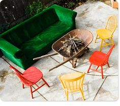 LOVE this for the firepit. Don't worry neighbors, not the couch or the wheelbarrow, but the painted chairs. I have enough.