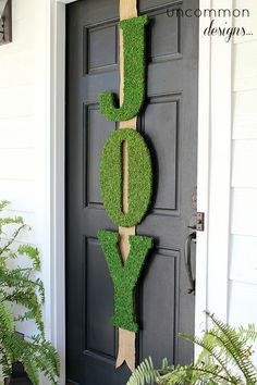 Moss-covered JOY letters