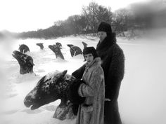 Still from Guy Maddin's film My Winnipeg.  Horses frozen in the Red River while trying to flee from a burning barn.