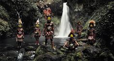 1. Huli – Papua New Guinea  The Huli Wigmen paint their faces yellow, red and white, combining them with ornate wigs they make from their own hair and don intimidating-looking axes, to frighten rival groups.