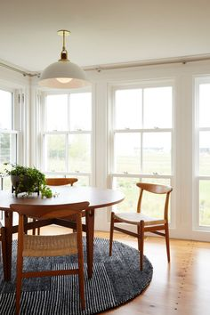 simple casual breakfast nook with mid-century style   modern shaker beach house tour on coco kelley