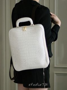 This is a faux leather backpack has crocodile pattern.  This can be a great everyday use and travelling.  The bag is very thick and so supple.  Youll