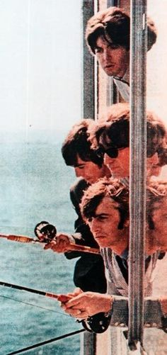 21st August 1964. The Beatles fishing out the window of the Edgewater Hotel on the Seattle waterfront.