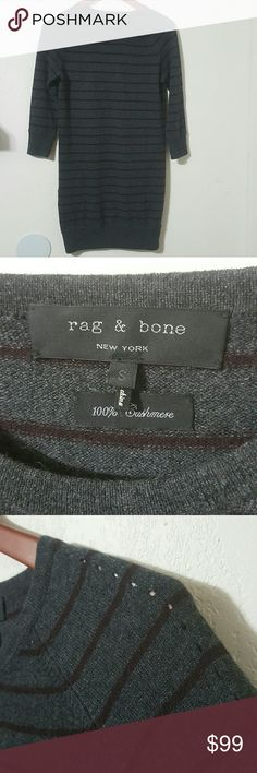 Rag and Bone 100% Cashmere Sweater Dress FLAW Charcoal and burgundy striped Authentic Rag and Bone sweater dress. Long sleeved. Has perforation details along the shoulders, down the arms and along the bottom half of the body. THERE IS A HOLE. the fifth picture shows the hole and the sixth picture shows the location on the dress. (lower right side, near the mid-size of body area) I do believe it could be fixed, but would hate to affect the integrity of the item, so I will leave that up to the…