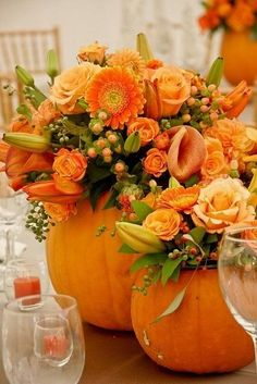 Not sure about pumpkins but colors are beautiful.  Fall wedding center piece Then everyone can chunk then in the pond