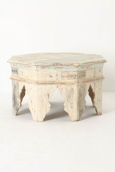 "anthropology .. moroccan inspired coffee table.... DETAILS An octagonal top of reclaimed wood planks sits majestically atop legs inspired by Moroccan archways. Reclaimed wood 17""H, 29"" diameter Imported"