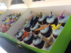 "Cupcakes with dragon toppers for a ""How To Train Your Dragon' party"