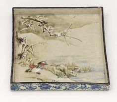 The dish illustrates the 12th month: The snow falls on the ice of the pond on which I gaze / piling up as does this passing year on all years past / And on the feathered coat of the mandarin duck | Square dish with design after Teika poems of birds & flowers | early 18th century | Ogata Kenzan (Japanese, 1663-1743) | Edo period | Buff clay; enamels, white slip & iron pigment under transparent lead glaze | Kyoto, Japan | Gift of Charles Lang Freer | Freer Gallery of Art | F1905.58