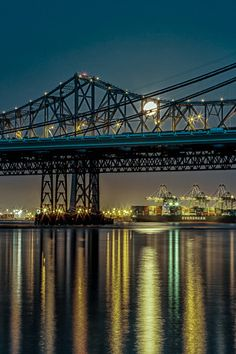 Black Gold - Super Moon Had to post another Super Moon shot from May. This one the moon is just passing through the Bay Bridge and reflecting nicely in the Bay!   Canon 7D Canon 70-200mm f/4 L ISO 100 f/16 30 Seconds  Buy this shot here: http://tobyharriman.smugmug.com/Photography/San-Francisco/23998223_S39VQZ#!i=1965441305=dZSZsfD