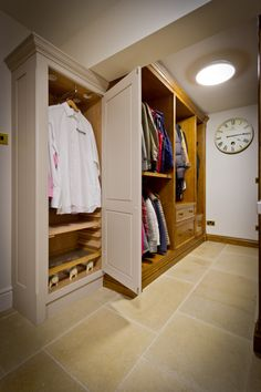 Bespoke cupboards house freshly laundered and ironed clothes and the adjoining units make the perfect space to store numerous coats