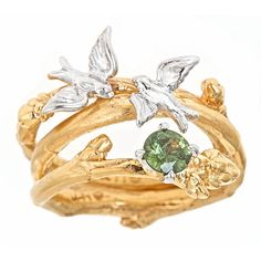 Swallow & branch engagement and wedding band with green sapphire
