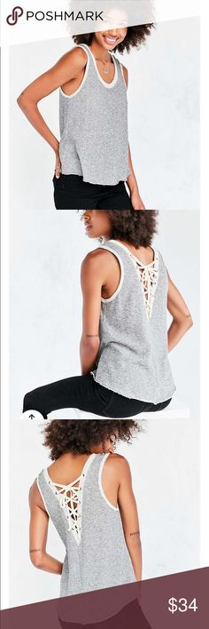 NWT UO ECOTE Textured Lace Up Back Tank Brand new with tags! Bought from Urban Outfitters, by Ecote. Really cool Lace Up back and great texture. Can be dressed up or down. Size: Large, Fits Medium and Large. Make offers if interested ❤ comes in original packaging! Urban Outfitters Tops Tank Tops