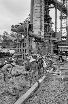 Workers enlarging a steel mill in Wuhan
