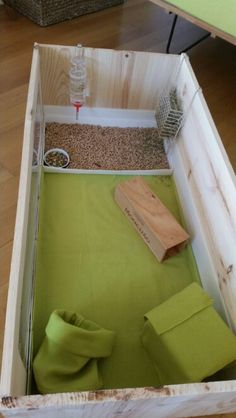 Wood cage with soft base and pellets zone