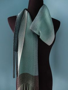 This handwoven tencel scarf has a warp that blends beautifully from black to charcoal gray to mineral green to birch grey. The scarf was woven in a plaited twill with a grayed teal weft that softens the underlying warp colors. Inkle Weaving, Weaving Art, Weaving Patterns, Hand Weaving, Lace Wrap, Weaving Projects, Plaits, Shawls, Fiber Art