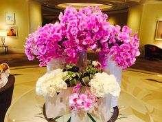 Pink orchids with white roses