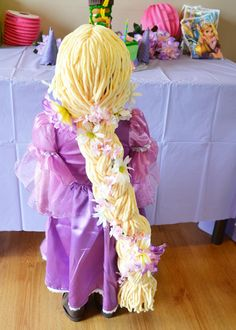 Adorable DIY Rapunzel braid wig made with yarn