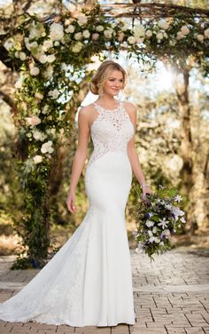 One of the most unique gown of the collection, this lace wedding dress with a high halter neckline was made for showing off a bride's curves!