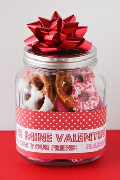 This is what we did for teacher gifts this year.  The kids had a blast making the pretzels!  Yummy!  And they eached picked out a different print for their jar label.  Cuteness.