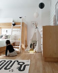 Scandinavian style kids room full of light and space to play