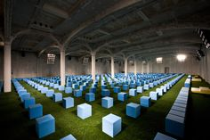 a geometric grid of individual blue foam blocks becomes an adaptable framework for both the audience and catwalk for the fashion label's current collection.