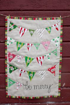 Count down the days until Christmas morning with this adorable handmade modern Advent Calendar! This piece is somewhat of a mini quilt,
