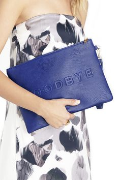 Fun, oversized navy clutch with HELLO printed on the front and GOODBYE on the back