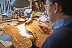 Violin maker at work in his workshop