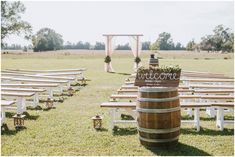 It doesnt get more picturesque then this intimate, country wedding set up.  The arch is simple yet beautiful and I love the idea of benches instead of chairs.  The welcome sign at the entrance to this outdoor ceremony is a great DIY detail as well.  Elizabeth Henson PhotosSamantha & Taylor - Lands End Plantation Wedding - North Carolina Photographer - Elizabeth Henson Photos