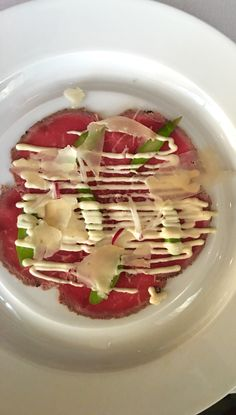 Charred Beef Carpaccio | The intimacy of Chops Grille provides the perfect at sea dining experience with a newly designed menu to awaken your taste buds.