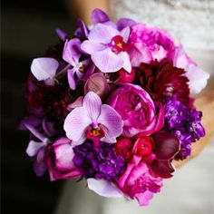 for bridesmaids?   bouquet of pink garden roses, bluish purple hydrangea and orchids.