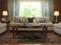 brown and blue modern living room, table lamps, sofa coffee table