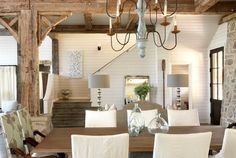 Tracery Interiors Lake House Alabama dining rm // love the look of the 3 different sized bottles on the table