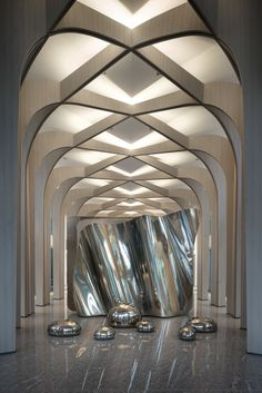 This modern build takes inspiration from ancient church architecture. We find it This modern build t Lobby Interior, Arch Interior, Interior Lighting, Lighting Design, Church Architecture, Interior Architecture, Ancient Architecture, Commercial Design, Commercial Interiors