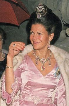 Queen Silvia of Sweden with the Romanoff pink topazes