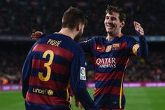 Barcelona's defender Gerard Pique (L) celebrates a goal with Barcelona's Argentinian forward Lionel Messi during the Spanish league football match FC Barcelona vs Sevilla FC at the Camp Nou stadium in Barcelona on February 28, 2016.