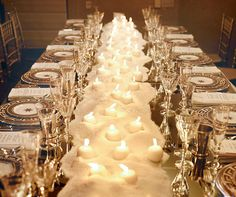 For a fabulous dinner party, a table runner was created out of white sand with votive candles buried inside.