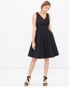 """A floral jacquard dress in classic black is a quintessential party must-have. The flattering V-neck is right on trend and gives a flirty finish when paired with our wide feather belt.   V-neck black jacquard fit-and-flare dress  Side seam pockets Invisible back zip with hook-and-eye closure Lined Approx. 39"""" from shoulder; hits at the knee  Cotton/polyester. Machine wash cold. Imported"""