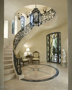 Mediterranean Staircase with Wall sconce, Concrete floors, Custom wrought iron stair railing, Stone Medallions, Arched window Home Stairs Design, Foyer Design, Dream Home Design, Home Interior Design, Luxury Kitchen Design, Railing Design, Mansion Interior, Interior Stairs, Luxury Staircase