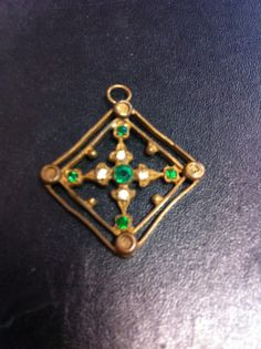 Art Deco vintage pendant with green crystal by yorkshiretreasure