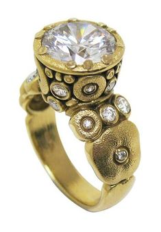 """This ring from Alex Sepkus always catches everyone's eye. From Alex's """"Orchard"""" collection, a round center stone of 11 to 11.4 mm can be set amongst .57 ctw of accent diamonds."""