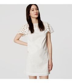 """Flutter sleeves end this effortlessly pretty cotton eyelet shift dress on a flirty note. Round neck. Short flutter sleeves. Yoke detail. Back zip. Lined. 19"""" from natural waist."""