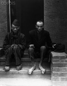 Concentration Camp Survivors Sitting on Steps - NA001138 - Rights Managed - Stock Photo - Corbis. Nordhausen Concentration Camp, Germany. April 12, 1945