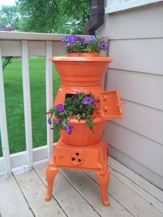 Spruce up that old stove with some bold paint and add plants for a gorgeous display outdoors!