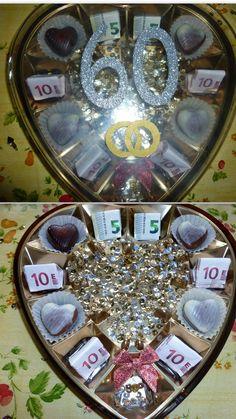 """Geldgeschenk zur  """"Diamantenen Hochzeit"""". Ich habe eine leere Pralinenschachtel genommen und sie abwechselnd mit Pralinen und Geld gefüllt. Innen habe ich sie noch mit goldenen und silbernen Pailletten beklebt. Aus Silber- und Goldpapier habe ich Ringe und die Zahl 60 auf den Deckel geklebt."""