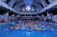 People attend the screening of the film 'Jaws' by director Steven Spielberg, screened at Strasbourg public baths during the European Fantastic Film Festival, in Strasbourg