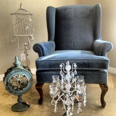 Vintage Accents! Found these great deals for a home library. Chair: $35 light blue velvet found at Habitat for Humanity;  Vintage Bird Cage: $2.00 found at Goodwill; Patina flower nautical candle accents set of 2: $40 found at Home Goods (www. Zaerltd.com); Crystal Candelabra: set of 2 small $29 and 1 large $49 found at Home Goods (www.opulenttreasures.com)